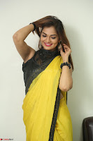 Cute Actress Ashwini in Yellow Saree Exclusive  045.JPG