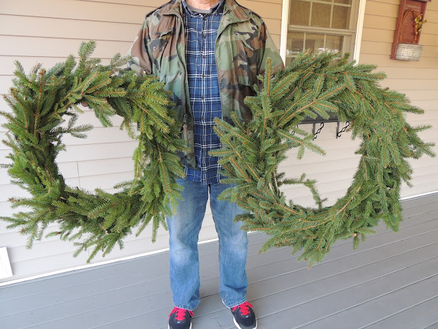 Two Christmas wreaths made by the Colonel for Walking on Sunshine.