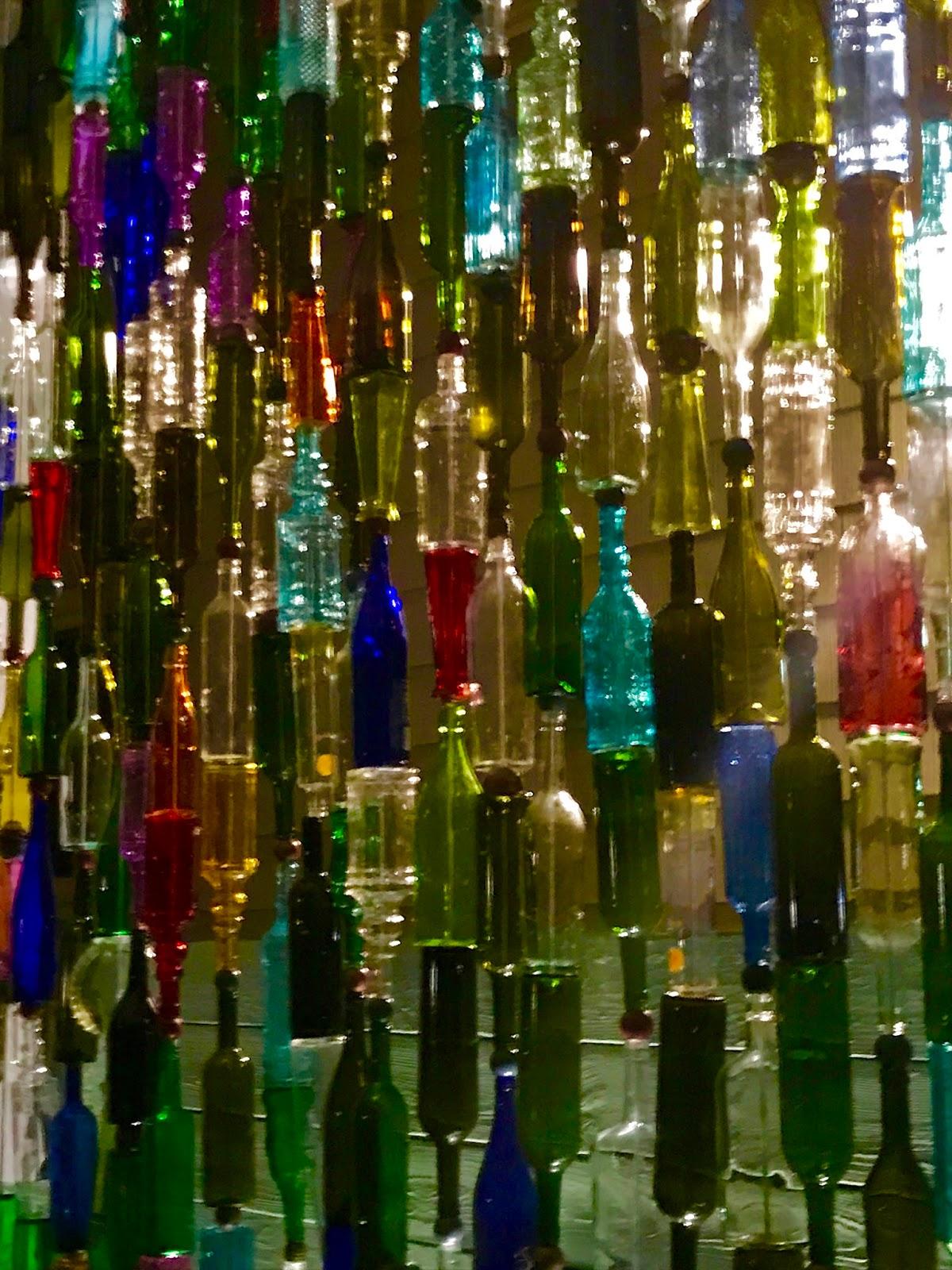 Garden art - a brilliant wine bottle wall