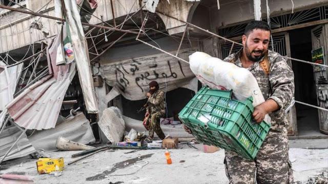 Mercenarios proturcos saquean propiedades de civiles en Alepo