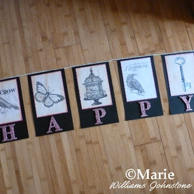 DIY handmade paper flag sections with bird, birdcage, key, and butterfly images