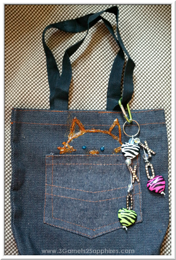 Tote bag decorated with glitter fabric paint & a DIY bag charm  |  3 Garnets & 2 Sapphires