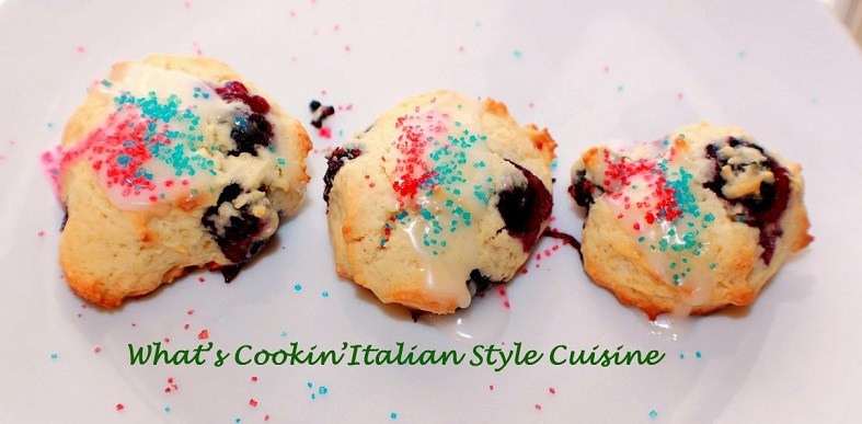 blueberry cookies with frosting and red and blue sugar on top for a festive look on the 4th of July