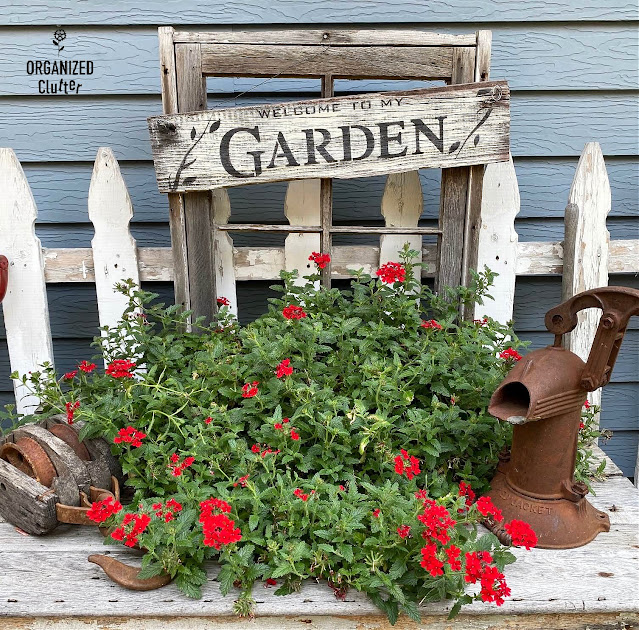 Photo of a window frame planter of red verbena
