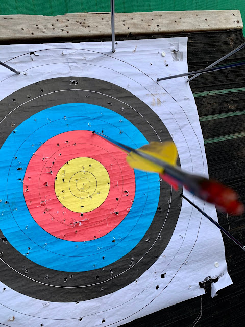 Archery target with arrows embedded