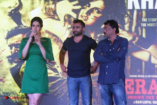 Bollywood Actress Zareen Khan Pictures in Short Dress at Veerappan Song Launch 0029