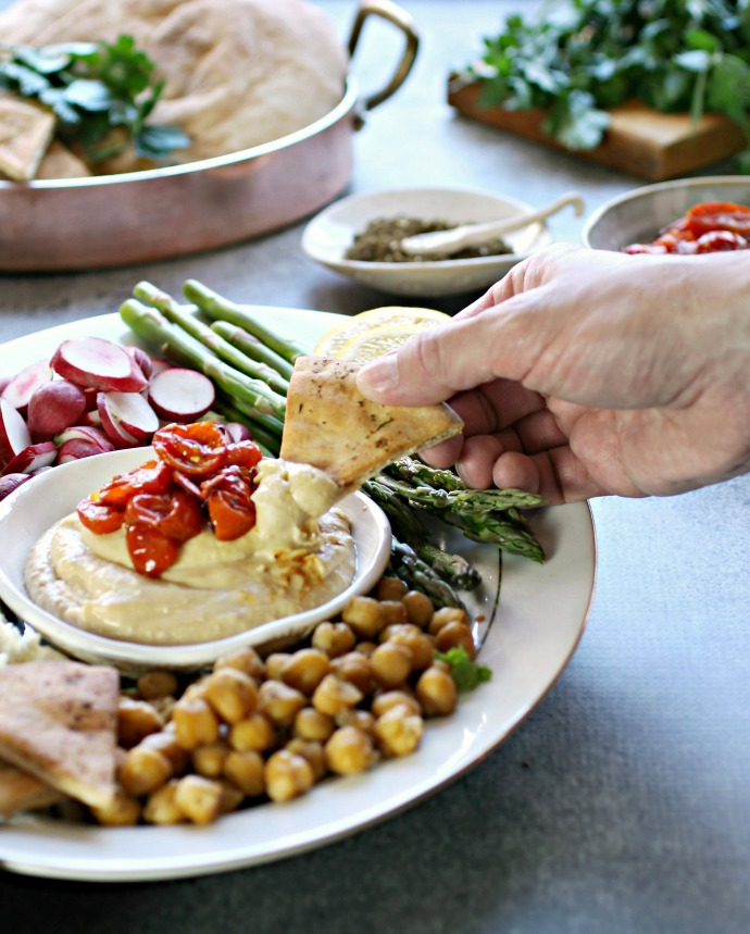 Recipe for roasted tomatoes and a tutorial on putting together a hummus party platter and fixings bar.