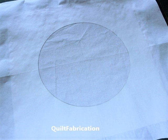 fold lines in fabric and freezer paper for aligning inset circles