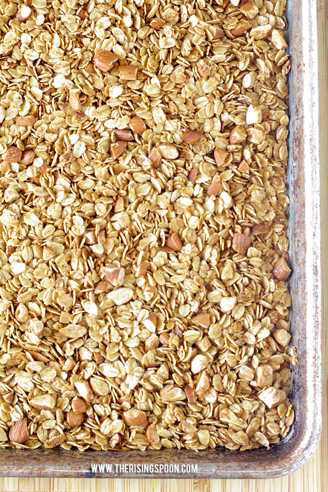 A healthy homemade granola recipe with coconut oil that's less sweet, but still packed with loads of flavor, crunch, and protein from homemade vanilla extract, real maple syrup, ground cinnamon, and chopped almonds.