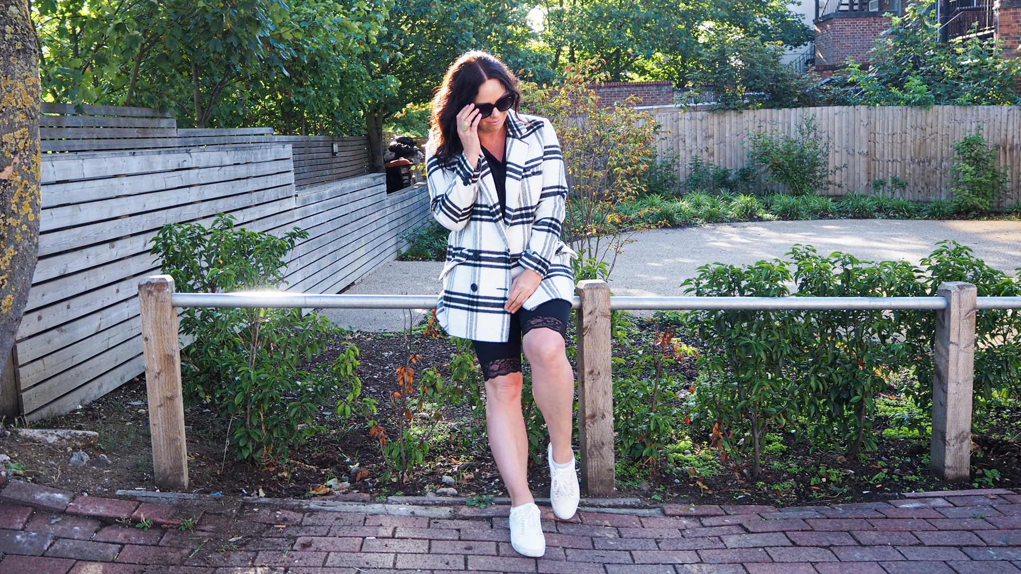 Black and white double breasted checked coat with lace hemmed bike shorts