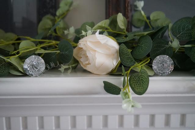 Rose garland with diamonds on mantel
