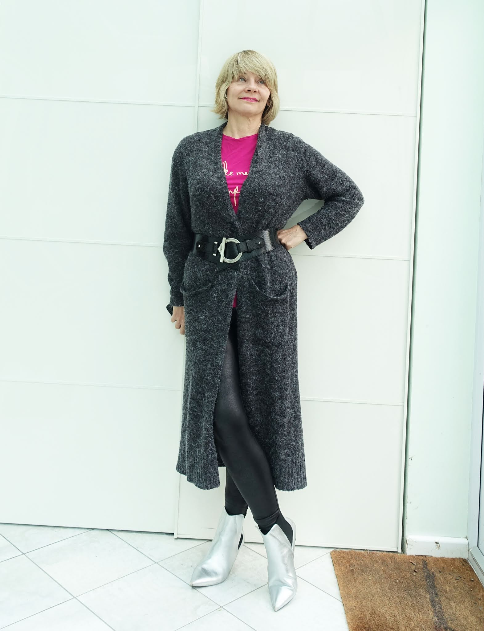 A long grey cardigan worn with a waist belt over a cerise tee shirt, worn by over-50s style blogger Is This Mutton