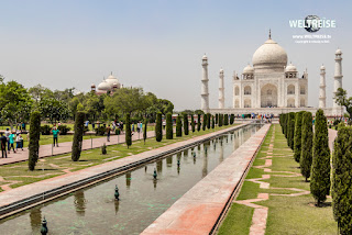 Taj Mahal in Agra, India. Mogul marble mausoleum with minarets, mosque and famous 17th century symmetrical gardens.
