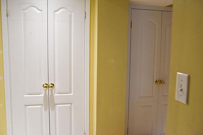Before shot of basement interior doors before painting