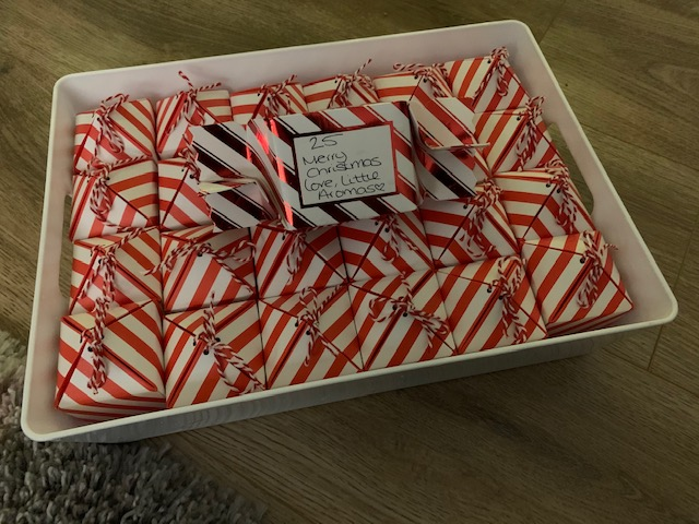 Wax melt advent calendar, with candy cane striped boxes in a tray
