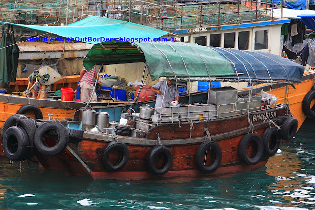 Congee selling on a sampan, Aberdeen Harbour, Hong Kong