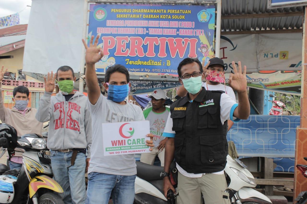 WMI Solok Raya Distribusikan Sembako dan Masker Untuk Dhuafa
