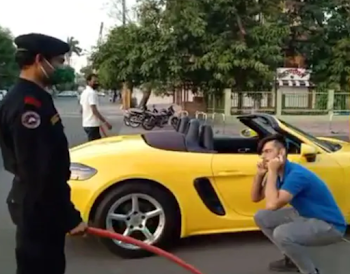 Porsche car owner made to do sit-ups like a school kid for violating lockdown
