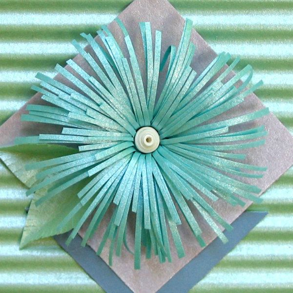 pastel pearlized paper asymmetric fringed flower close up