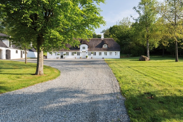 Gravel driveway and magnificent exterior of Danish farmhouse on Hello Lovely Studio
