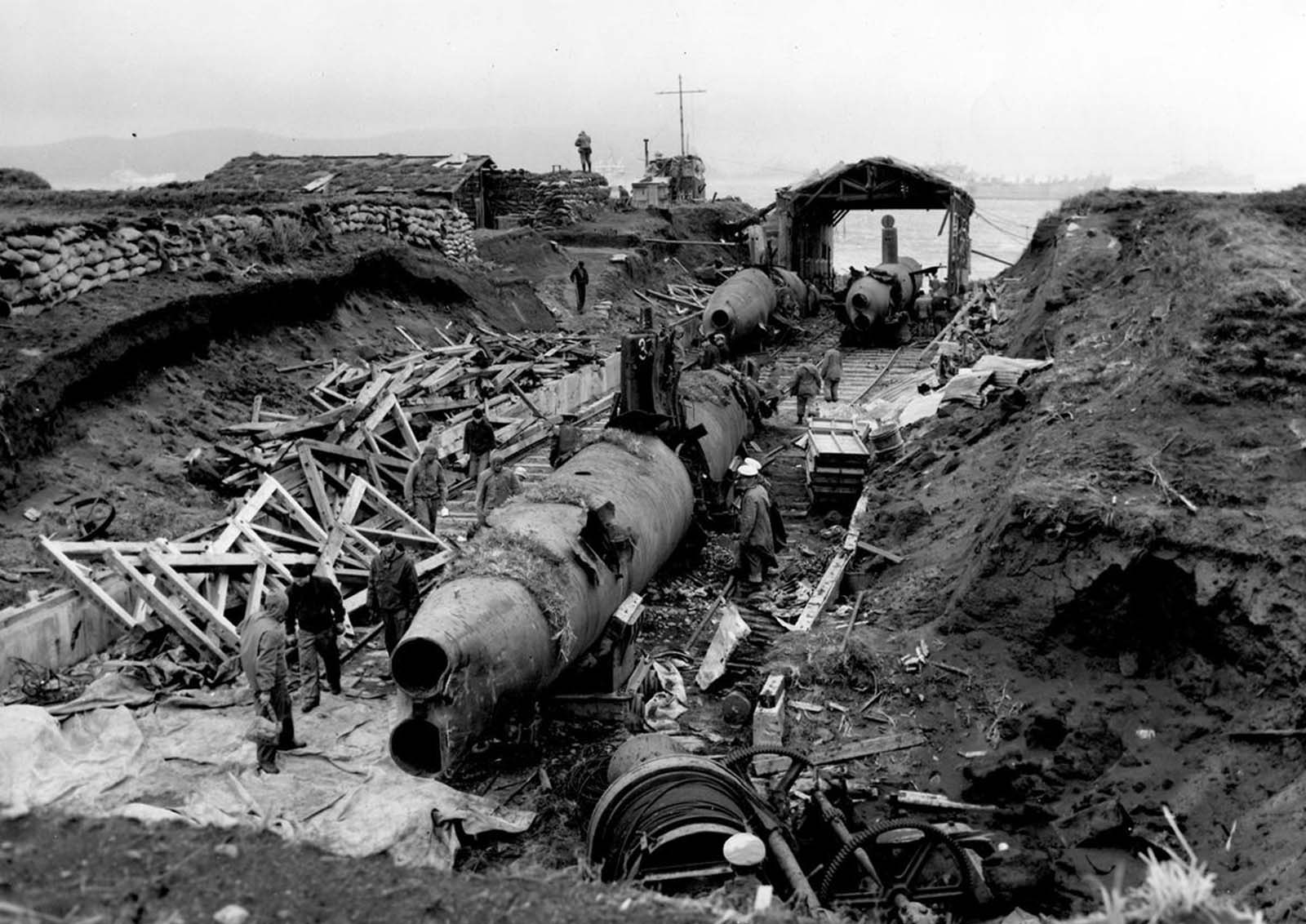 A heavily damaged midget submarine base constructed by occupying Japanese forces on Kiska Island, photo taken sometime in 1943, after Allied forces retook the island.