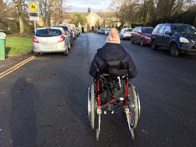 ME Advocate Ireland (MEAI) member in wheelchair on the road
