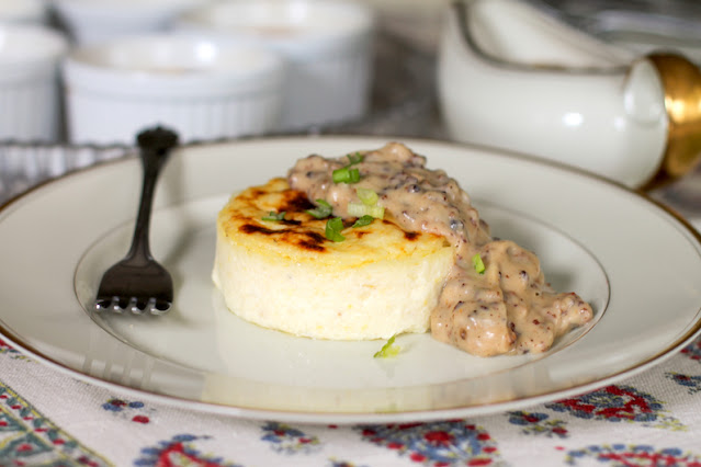 Food Lust People Love: Melt-in-your-mouth cheesy baked grits with sausage gravy are a true southern comfort food I'm sure the whole world would enjoy. You need to try them if you haven't already!