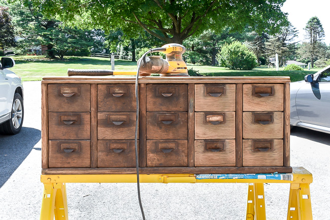Sanding vintage wood card catalog