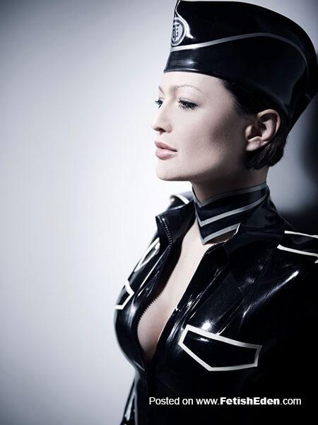 Lady in black latex military uniform
