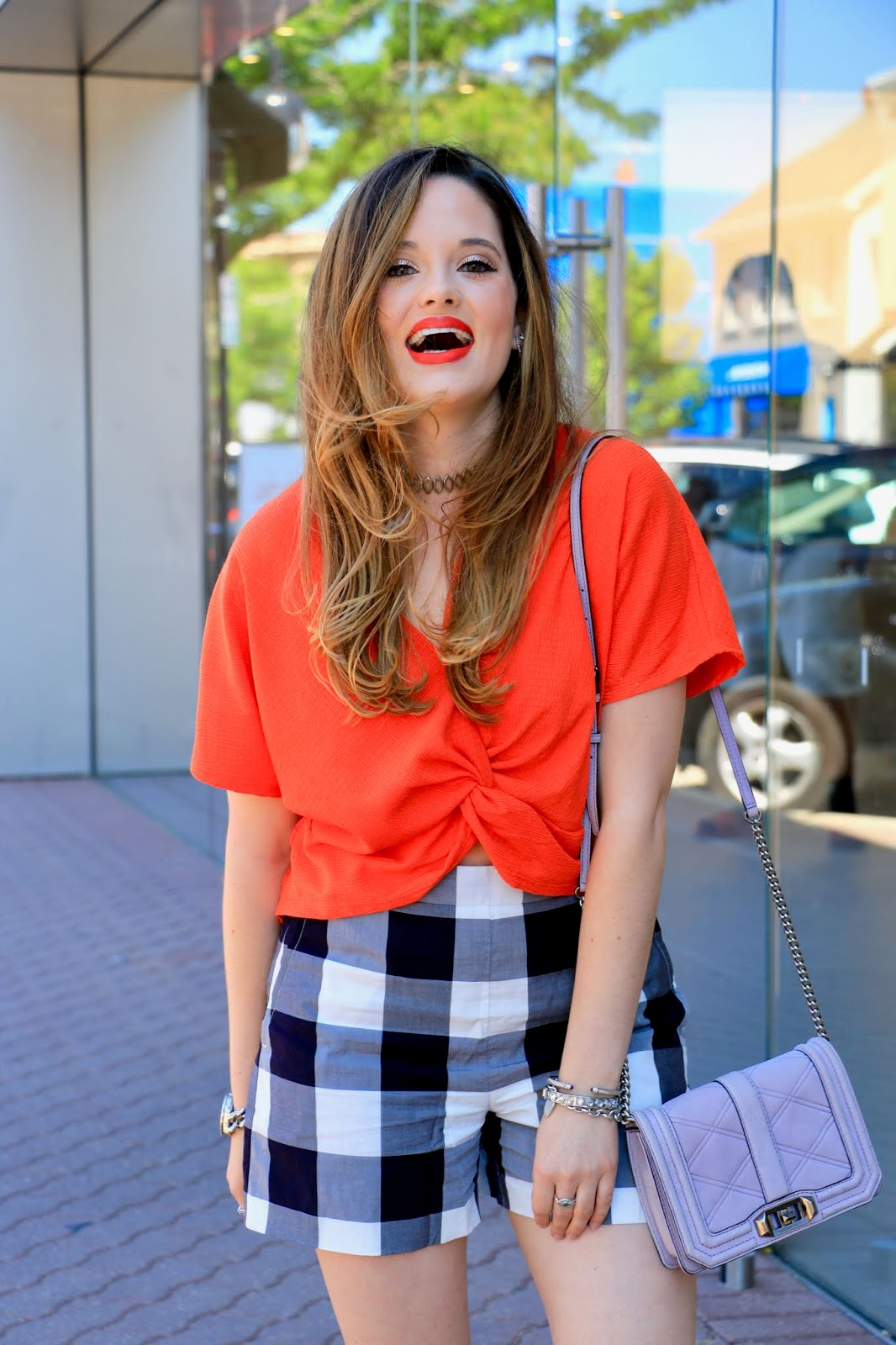Nyc fashion blogger of Kat's Fashion Fix, Kathleen Harper, wearing high-waisted plaid shorts