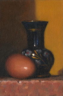 Still life oil painting of an egg beside a small blue glass vase with painted flowers.