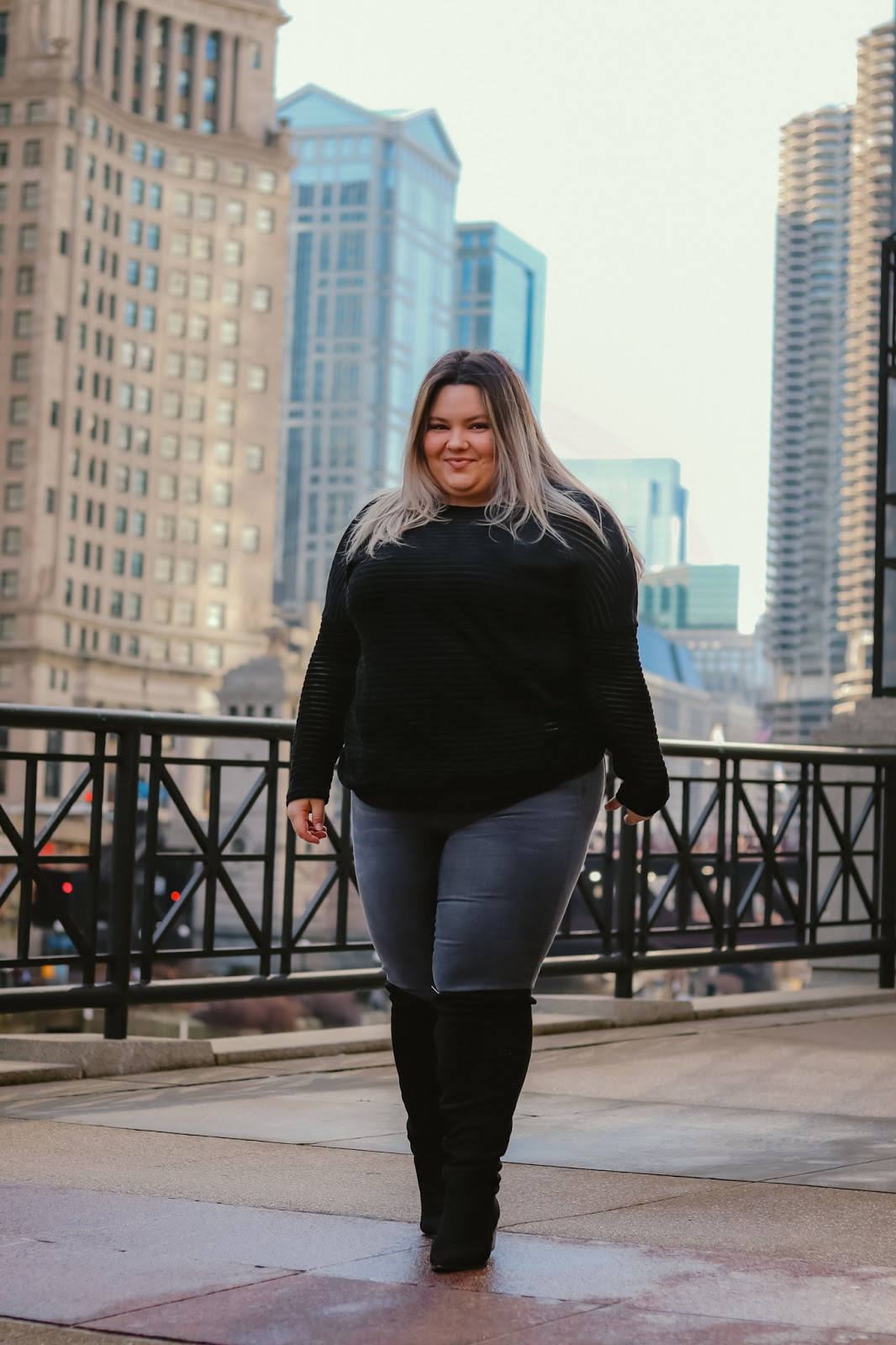 Chicago Plus Size Petite Fashion Blogger, influencer, YouTuber, and model Natalie Craig, of Natalie in the City, reviews Chic Soul's comfortable jeans and sweaters.