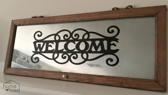welcome sign with mirror paint and vinyl welcome sign