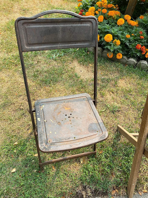 Photo of a vintage metal child's folding chair