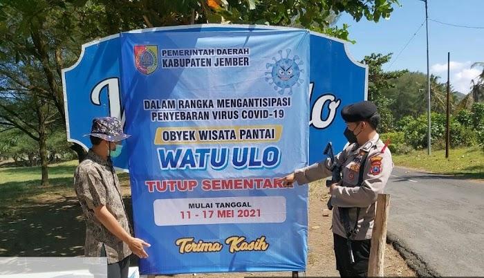 Polsek Ambulu Pasang Himbauan Tutup Sementara di Pantai Wisata Watu Ulo