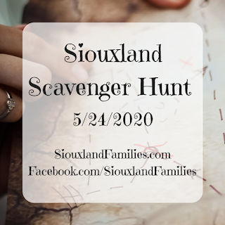 "In background, a hand sits on top of a treasure map. in foreground, the words ""Siouxland Scavenger Hunt 5/24/2020"" and ""SiouxlandFamilies.com  Facebook.com/SiouxlandFamilies"""