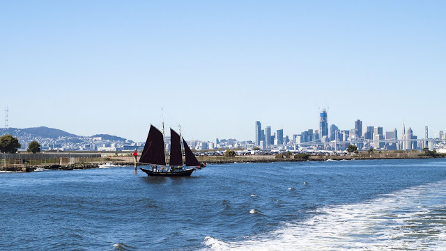 3-masted sailboat and San Francisco Skyline viewed from the San Francisco Bay Ferry