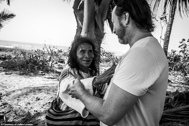 Julian takes a turn in front of the camera, and he is seen being patted by a smiling Kogi tribesman. He said this was taken after a ceremony, which gave him 'strength and spiritual protection', and welcomed him into the Kogi family. 'Only a few were given this privilege,' Julian explains