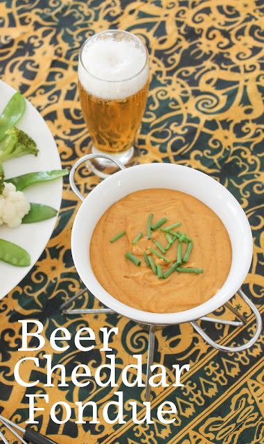 Food Lust People Love: Beer Cheddar Fondue is made with sharp cheddar cheese mixed and melted with beer. You won't be able to stop dipping in till it's gone. Serve with lightly steamed vegetables and/or crusty bread. A great snack or, indeed, meal!