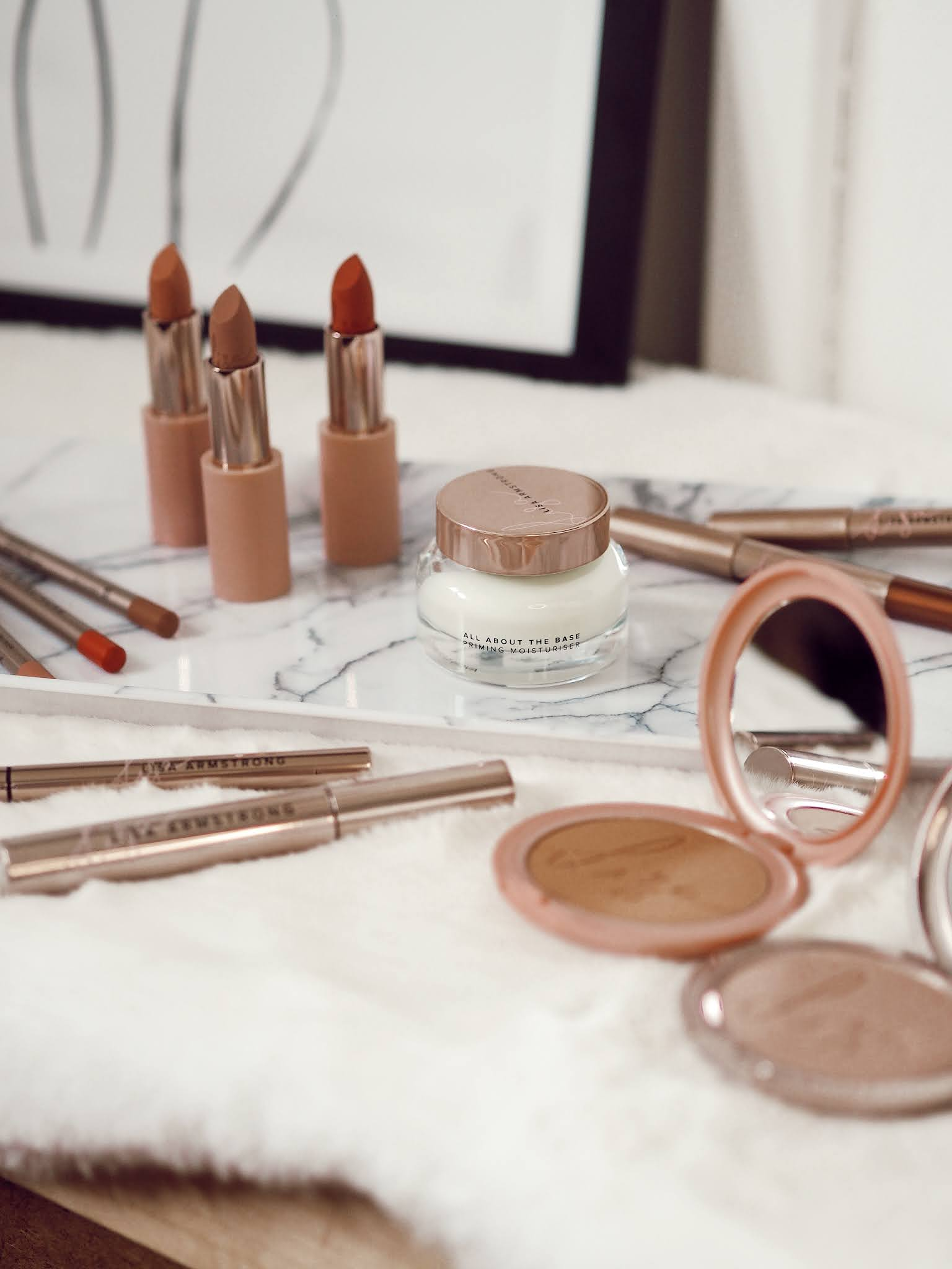 Makeup products from the Lisa Armstrong x Avon Collection