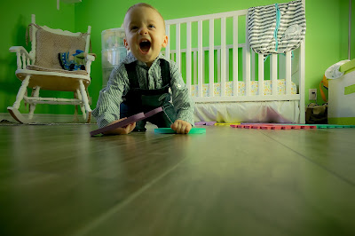A cute happy baby boy at crawling age