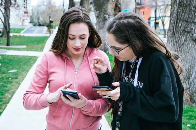 Two Girls Wearing Gym Sweatshirts