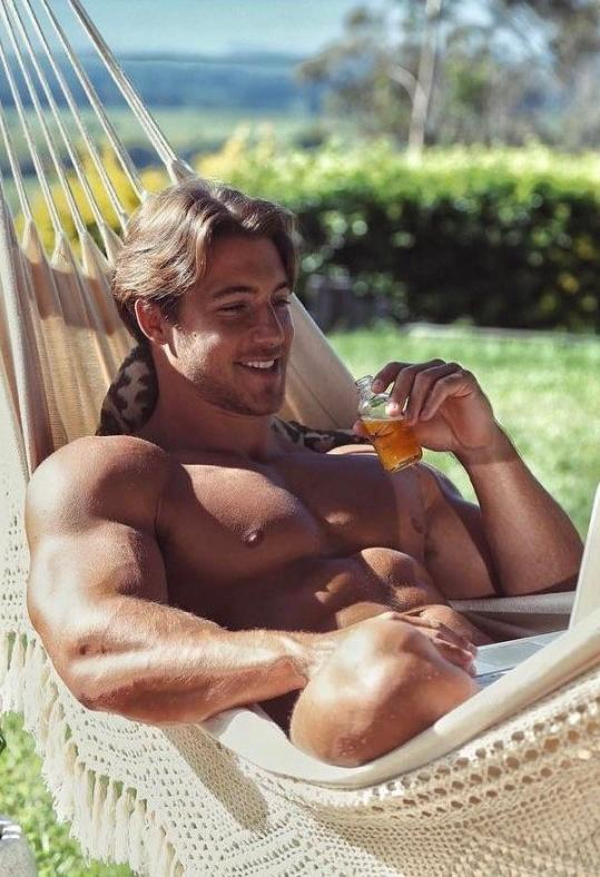 hot-shirtless-guy-biceps-pecs-abs-smiling-drinking-outside-summer