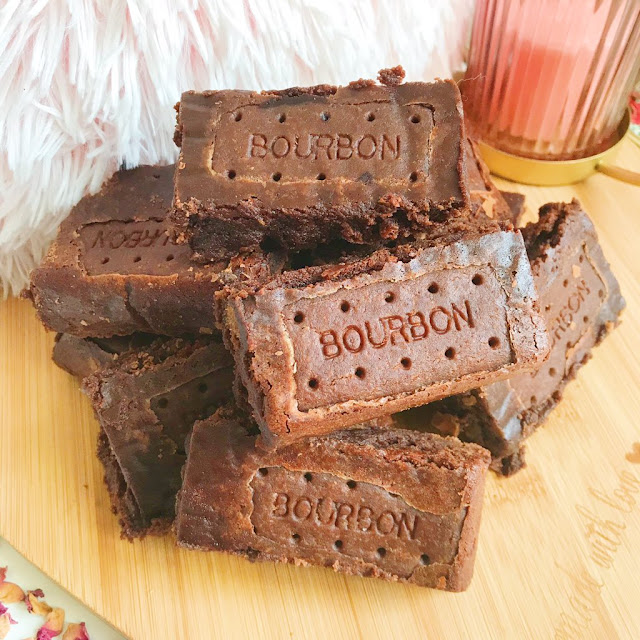 stack of bourbon brownies on heart shaped wooden chopping board