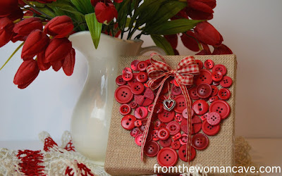 http://www.fromthewomancave.com/2015/01/14/a-pretty-little-button-heart-canvas/