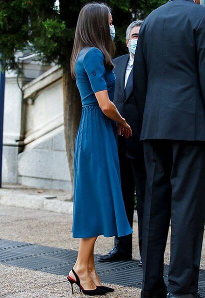 Queen Letizia wore a v-neck embroidered crepe dress from Bottega Veneta, and slingback black pumps from Carolina Herrera