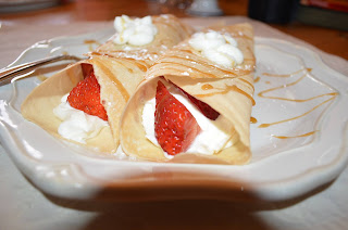 Strawberry cream cheese crepes on a plate