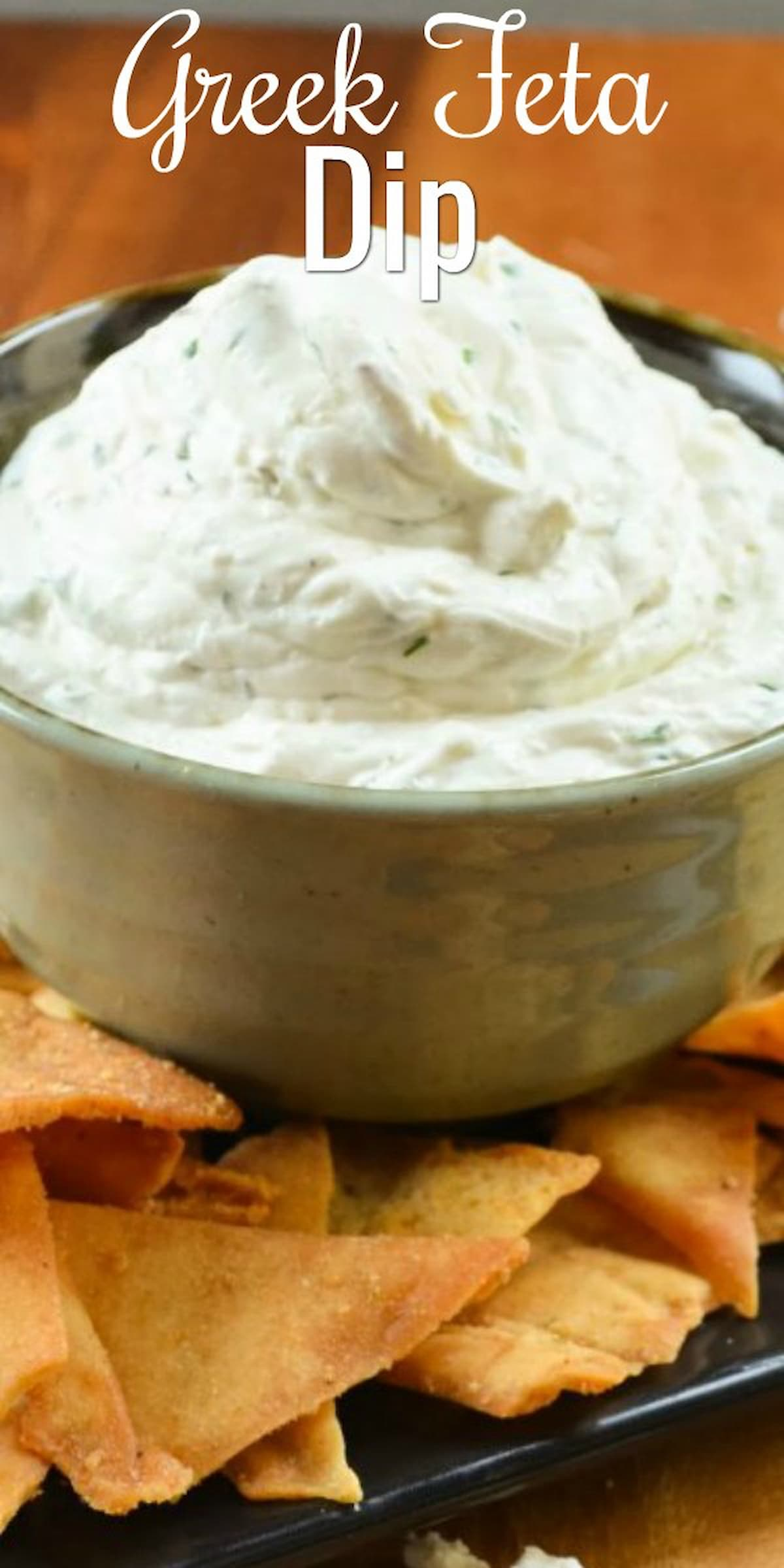 Greek Feta Dip in a bowl with pita chips around the edge.