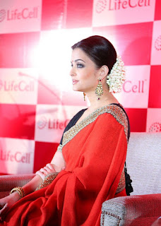 Aishwarya Rai Red Saree Sitting Pose 2