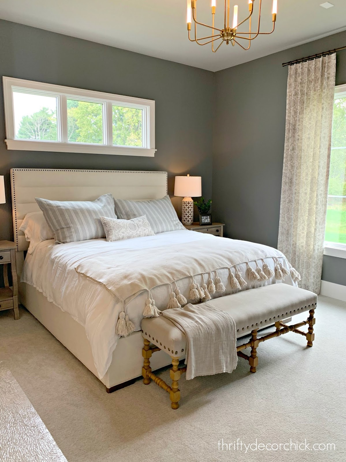 dark gray walls light bedding